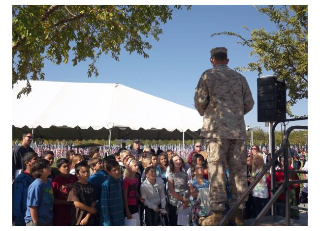 A Veteran Presents to 5th Graders from a Stage