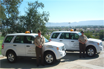 Park Rangers Joe Carpenter and Melecia Price Stand Beside Their Vehicles